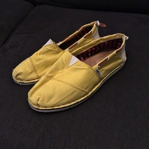 Yellow canvas Toms flats